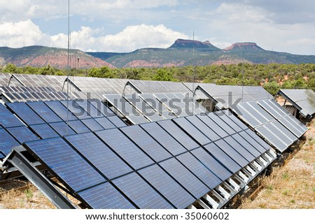 An array of solar panels provides power in the mountains - stock photo