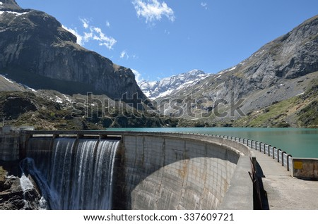 An artificial lake is formed with the Gloriettes dam on the Gave d'Estaube river in the Haute Pyrenees. - stock photo