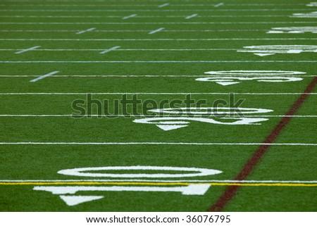 An Artificial turf American football field - horizontal - stock photo