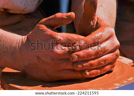 An artisan is making a pot in his workshop. Pottery - stock photo