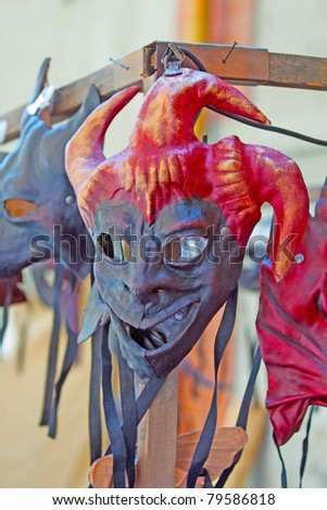 An artisanal demon red and black mask - stock photo