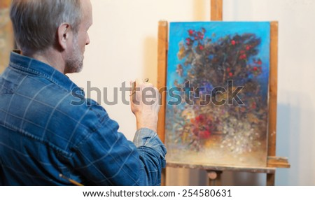 An artist painting - stock photo