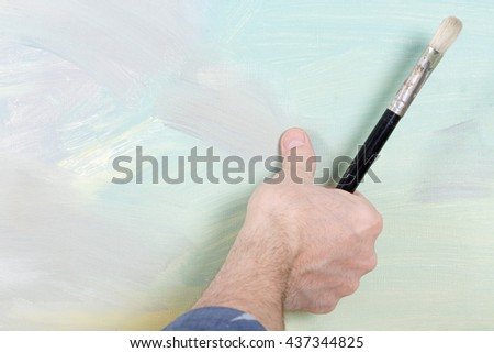 An artist painting in studio - stock photo