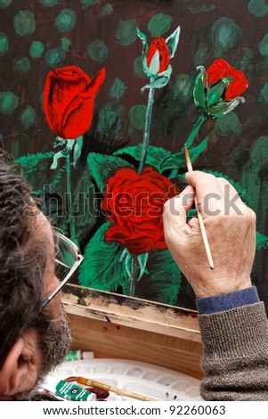 An artist painting on easel