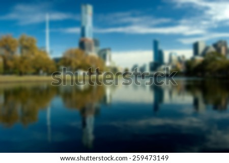 An Artistic Blurred Photo of a City Skyline (Melbourne) - stock photo
