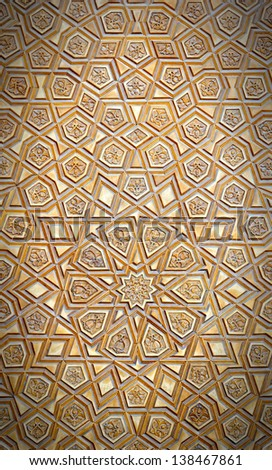 An artistic carved pattern in wood of an islamic arabic nature. - stock photo
