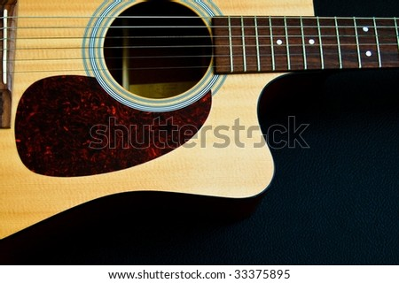 An Artistic Framing of a Beautiful Acoustic Guitar Body - stock photo