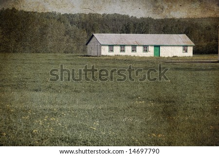 An artistic old-fashioned view of a farm shed. - stock photo