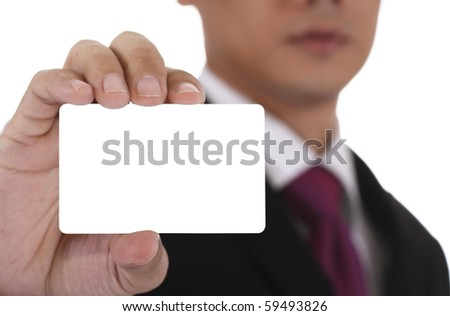 An Asian businessman displaying a blank business card. Clipping path included for the card. - stock photo