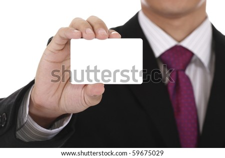 An Asian businessman displaying a blank card. Clipping path included for the card. - stock photo