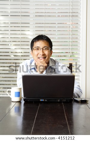 An asian businessman working on his laptop