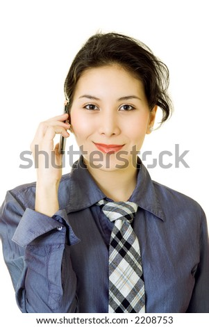 An asian businesswoman talking on the phone - stock photo
