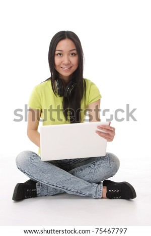 An asian college girl with a laptop sitting on the floor