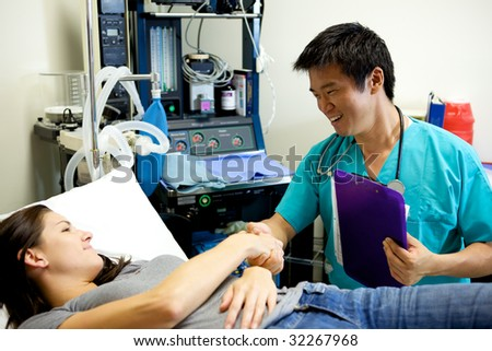An Asian Doctor Working in a Hospital - stock photo