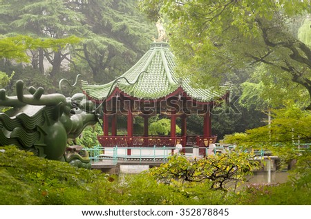 An asian gazebo on a foggy and rainy afternoon at Ding Xiang Garden in Shanghai China.  - stock photo