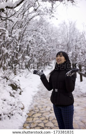 An asian girl in the winter - stock photo