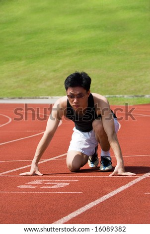 An asian male athlete is ready to start off. Its abstract meaning is the business is ready with all the requirements to get started!