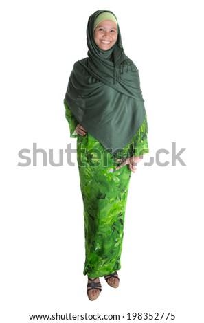 An Asian Muslim Malay woman with Baju Kurung, the Malaysian National dress and green hijab. - stock photo