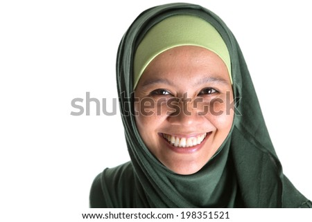 An Asian Muslim Malay woman with green hijab over white background - stock photo