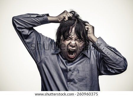 An Asian office guy is stressing to his limit in white background  in heavy grain grunge style - stock photo