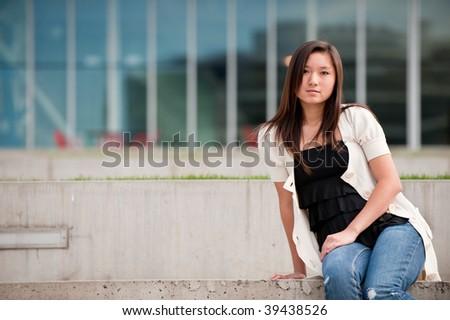 An Asian teenage girl staring - stock photo