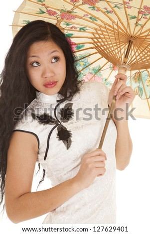 An Asian woman in her traditional dress holding her umbrella. - stock photo
