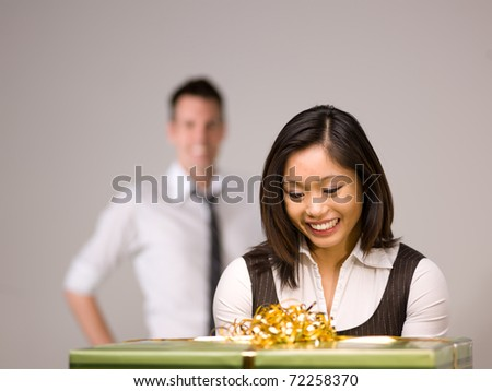An Asian woman is excited to receive a gift - stock photo