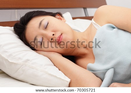 An Asian woman sleeping at home