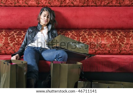 An Asian woman, tired after a shopping frenzy - stock photo
