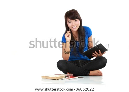 an asian woman writing abook isolated - stock photo