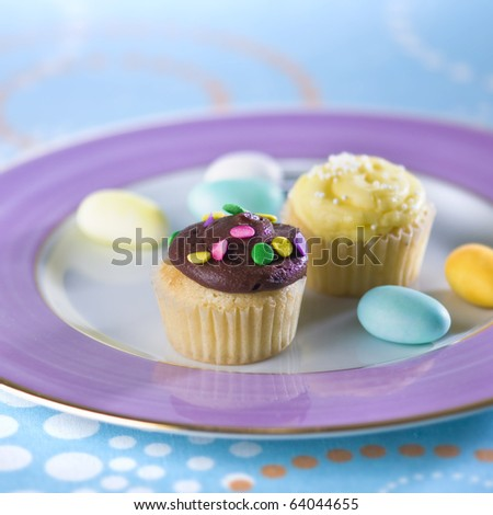 An assorted cup-cakes with almond candies. - stock photo
