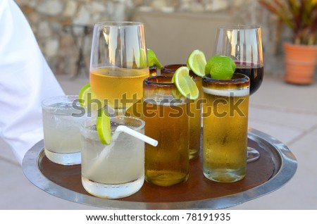 An assortment of cocktails on a Platter beer ,wine and tequila - stock photo