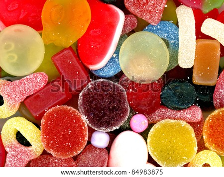 An assortment of colorful candy with jellybeans, gumdrops and other jelly candies