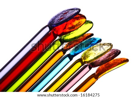 An assortment of colorful glass cocktail stirrers