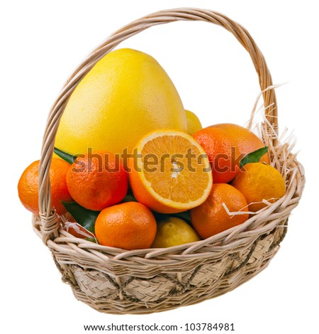An assortment of fresh fruits in basket isolated on white background. Orange, mandarin, grapefruit, lemon.
