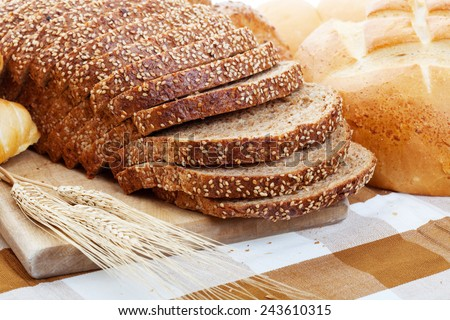 An assortment of freshly baked breads.  Shallow depth of field. - stock photo