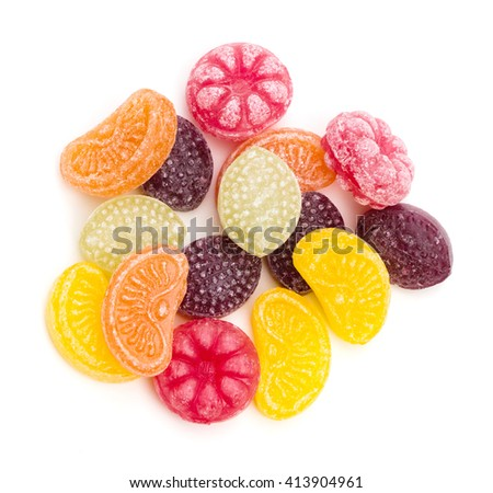An assortment of fruit flavored hard candy on a white background - stock photo