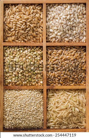 An assortment of healthy whole grains in a wooden box.