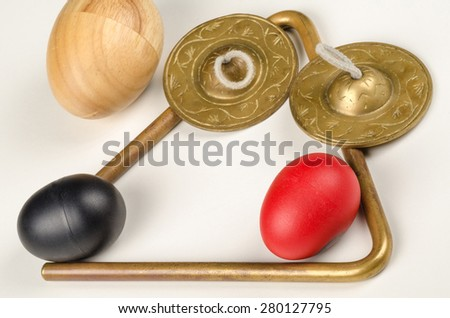 An assortment of small percussion instruments on white - stock photo