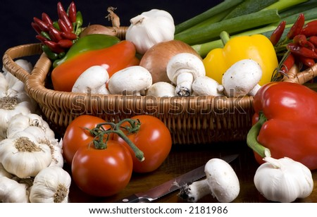 An assortment of vegtables fresh from the garden, ready for cooking - stock photo