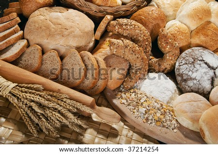 An assortment of whole grain wheat breads on a table