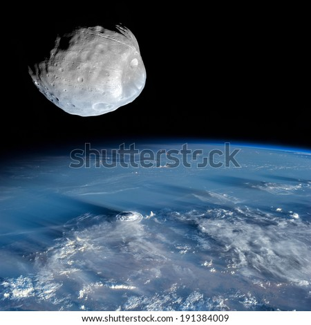 An asteroid high above the Earth. Elements of this image furnished by NASA.  - stock photo