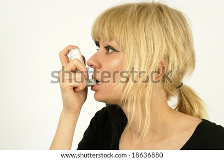 An asthma sufferer using an inhaler.