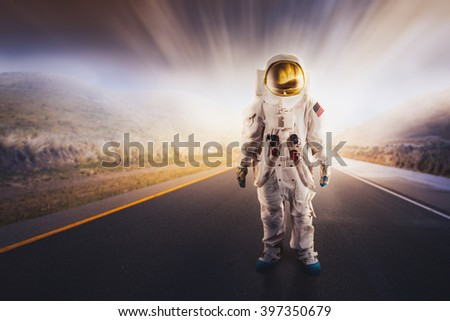 An Astronaut standing on a road - stock photo