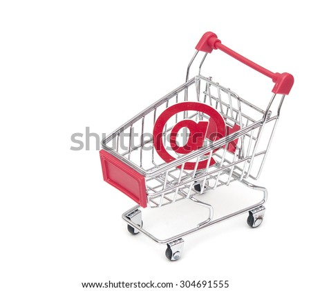 an at sign in a shopping cart, depicting the concept of e-shopping or e-commerce - stock photo