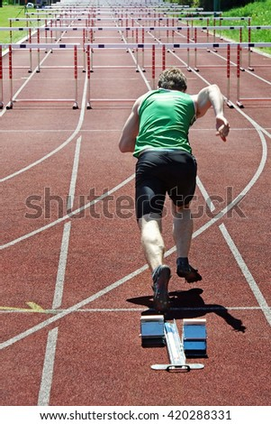 An athlete at the starting block - stock photo