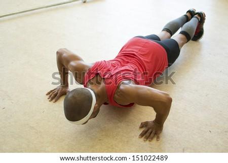 An athlete doing push ups. - stock photo