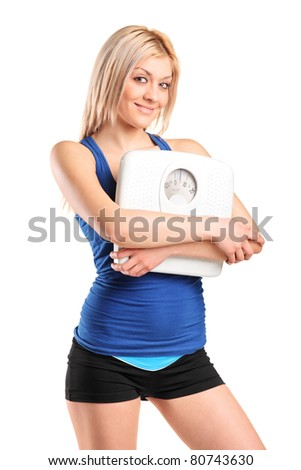 An athlete female holding a weight scale isolated on white background - stock photo