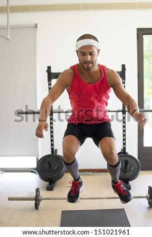 An athlete jumping. - stock photo
