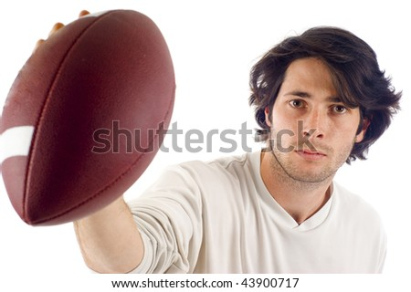 An athletic man is throwing a football at the camera isolated over white,  text message on the football